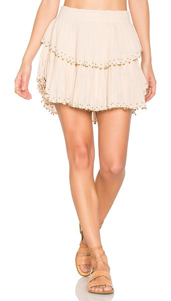 LoveShackFancy Ruffle Mini Skirt in tan - 100% cotton. Hand wash cold. Fully lined. Elasticized...