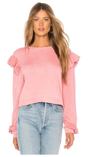 LoveShackFancy Ruffle Sweatshirt in pink - 100% cotton. Intentional color variation throughout....