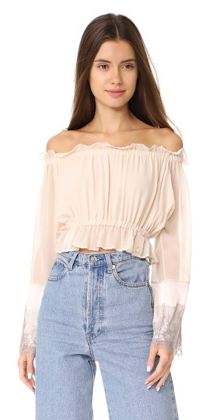 LOYD/FORD peasant crop top in blush - Ruffles accentuate the off-shoulder neckline and...