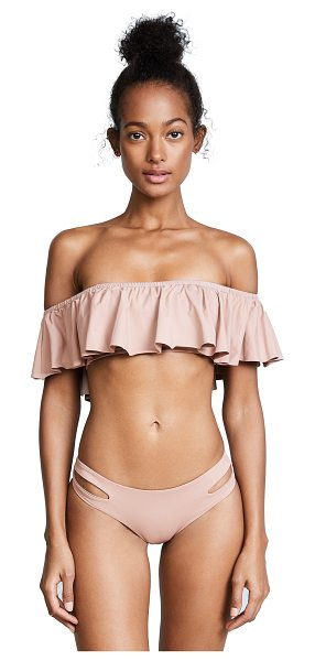 L*SPACE l*space hey girl bikini top in dusty pearl - A flirty ruffled overlay lends breezy style to this...