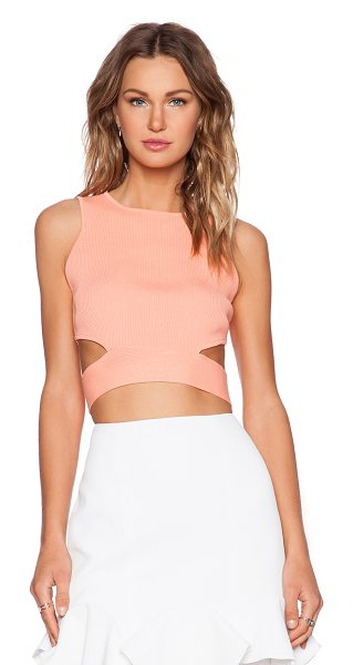 Lucy Paris Rib cutout crop top in coral - 52% viscose 48% nylon. Side waist cut-outs. Exposed back...