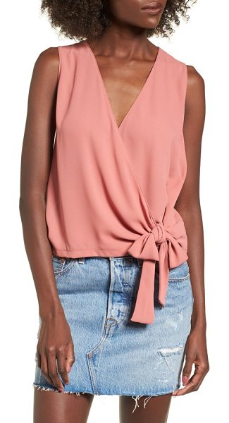 Lush wrap tank in coral solid - Draped and knotted at the waist, this wrapped tank is...