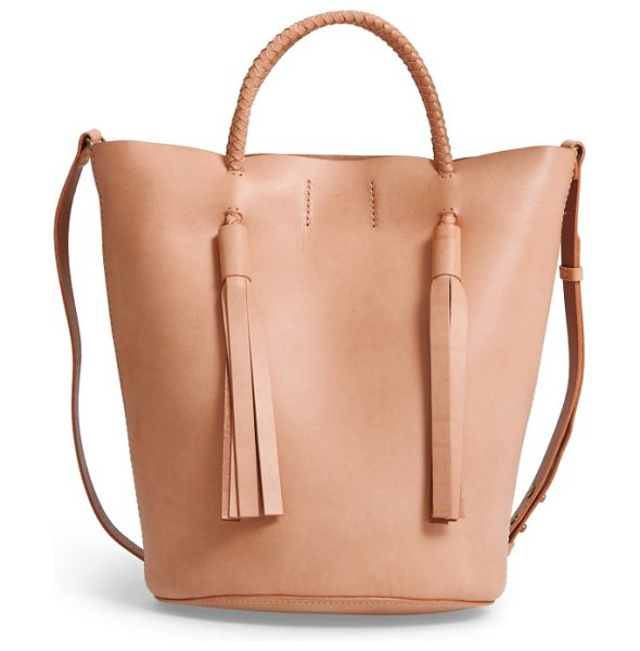 Madewell austin leather bucket bag in natural buff - Braided straps and dramatic tassels add textural...