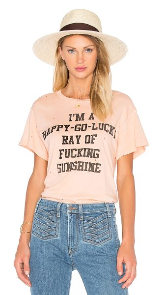 MADEWORN I'm A Happy Go Lucky Tee in peach - 100% cotton. Velveteen textured front graphic print....