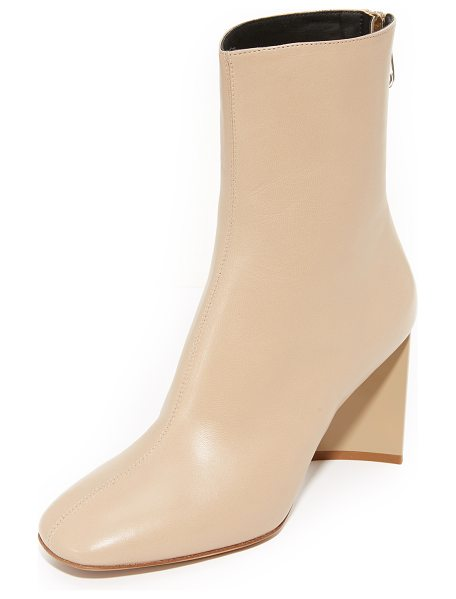 MAISON MARGIELA cutout heel ankle booties in nude - An asymmetrical, acrylic heel adds a bold finish to...