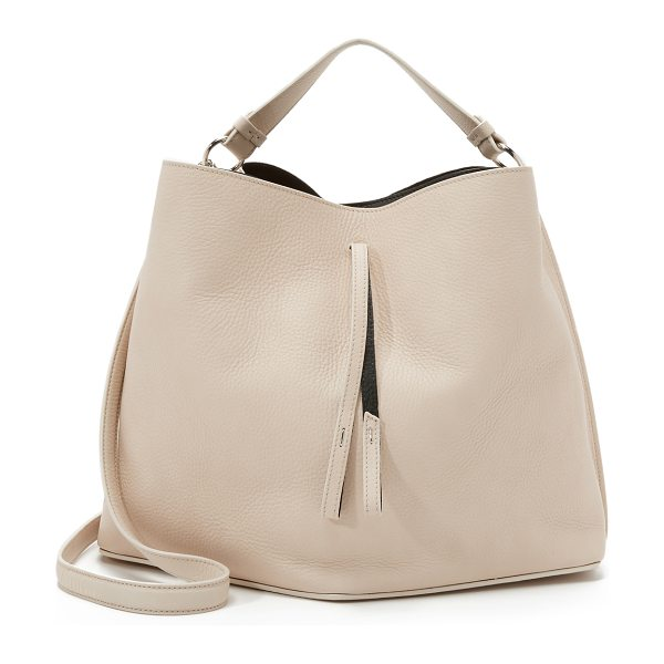 MAISON MARGIELA Leather bag in beige/black - A striking Maison Margiela bucket bag in soft leather....