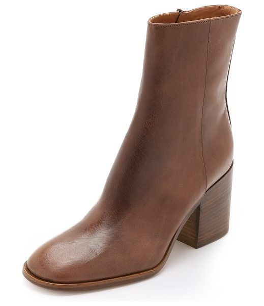 MAISON MARGIELA Leather booties in taupe - A chunky, stacked heel gives these variegated leather...