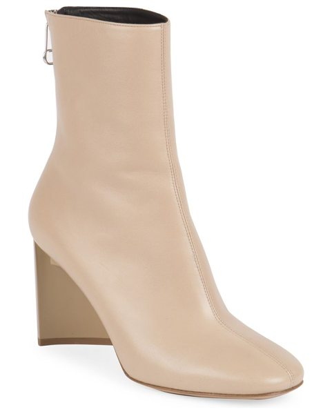 MAISON MARGIELA leather booties in nude - Architectural heel elevates retro-chic leather bootie....