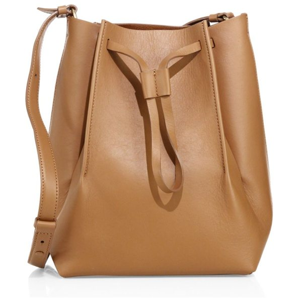 MAISON MARGIELA leather bucket bag in brown - Tall structured leather bucket bag with drawstring top....