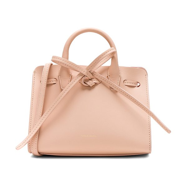 "Mansur Gavriel Mini Mini Sun Bag in pink - ""Calfskin leather with tonal matte patent leather lining..."