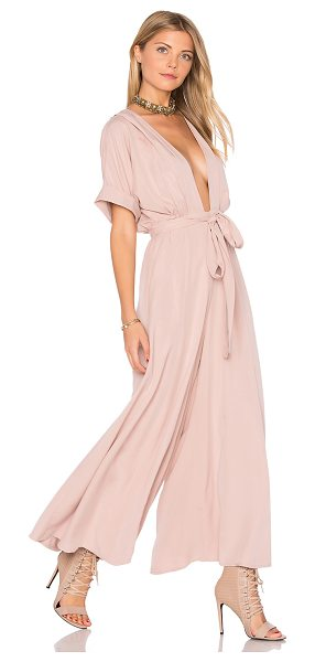 Mara Hoffman Deep V Jumpsuit in mauve - Rayon blend. Hand wash cold. Waist tie. Cuffed sleeves....