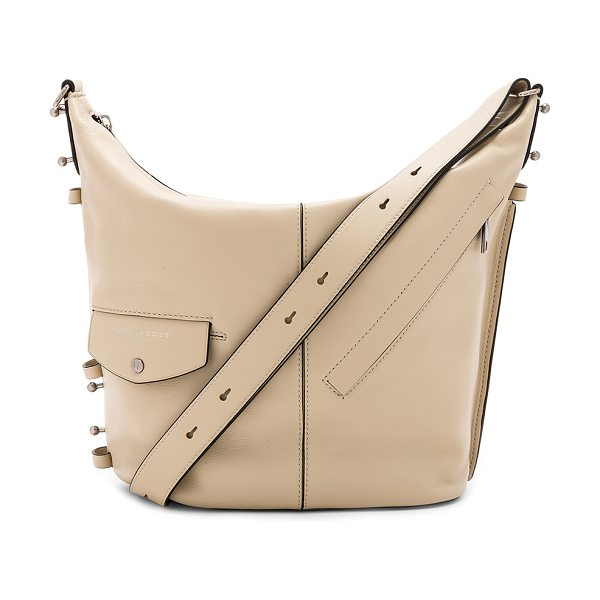"""MARC JACOBS The Sling Bag in beige - """"Leather exterior with nylon fabric lining. Zip top..."""