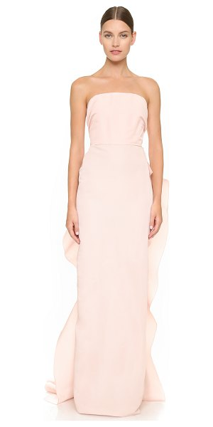 Marchesa Strapless silk faille column gown in blush - Cascading ruffles flow in gentle curves over the back of...