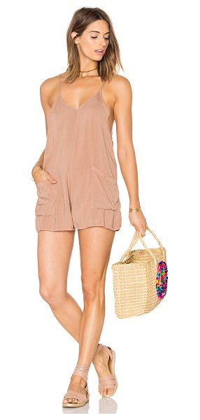 MATE the Label Riley Romper in sand - Rayon blend. Adjustable shoulder straps. Front pockets....