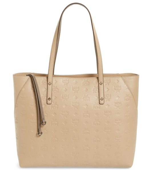 MCM klara monogrammed leather shopper in new beige - Logo-embossed leather brands a chic shopper featuring...