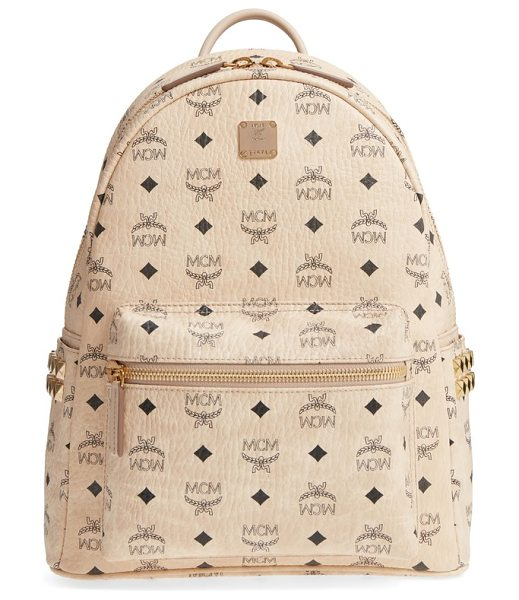 MCM medium stark side stud coated canvas backpack in beige - Gleaming pyramid studs add a little cool-girl edge to a...