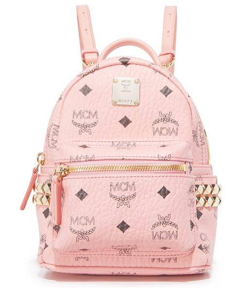 MCM mini stark backpack in soft pink - A petite MCM backpack monogrammed in the brand's logo....