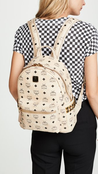 MCM small stark backpack in beige - Fabric: Coated canvas Logo pattern Exposed zip at top...