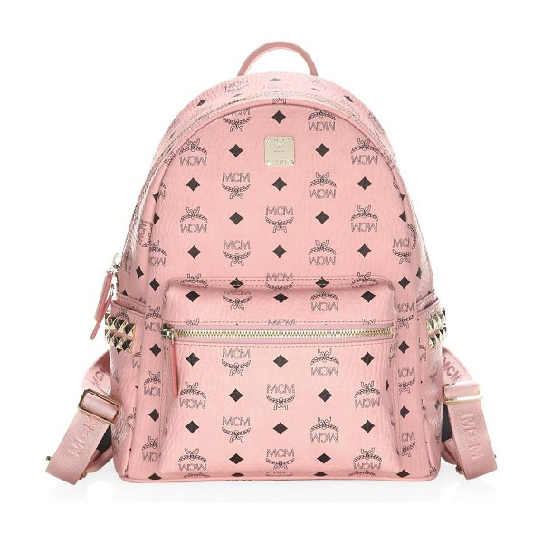 MCM small stark canvas backpack - Graphic logos adorn canvas backpack in allover fashion....