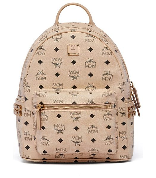 MCM mini stark studded coated canvas backpack in beige - Signature logo-print backpack with side stud detail. Top...