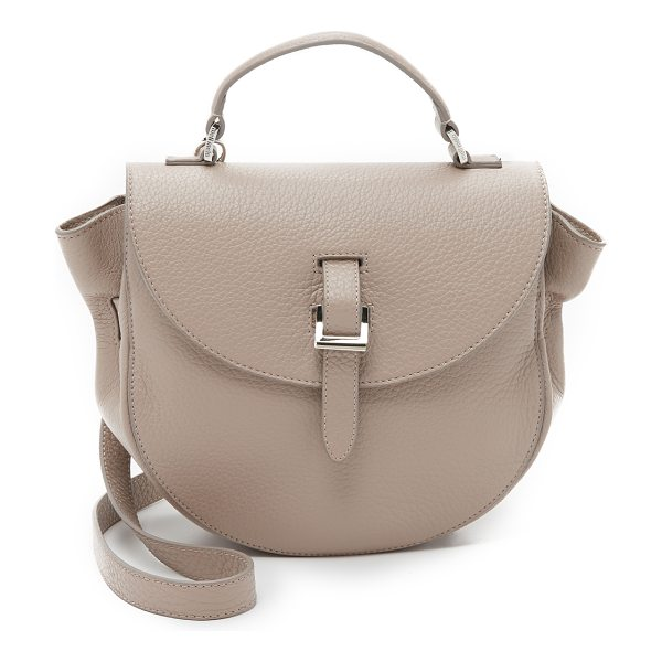 meli melo Ortensia saddle bag in taupe - A pebbled leather meli melo saddle bag with a magnetic...
