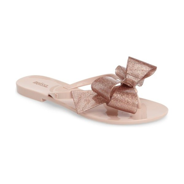 Melissa harmonic bow iii flip flop in sand - An oversize metallic bow sparkles atop a simple...
