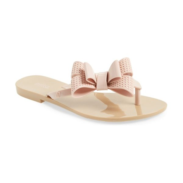 Melissa harmonic bow iii flip flop in pink - An oversize metallic bow sparkles atop a simple...