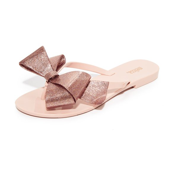 Melissa harmonic bow iii flip flops in nude - A bold, glittery bow details the thong strap on these...