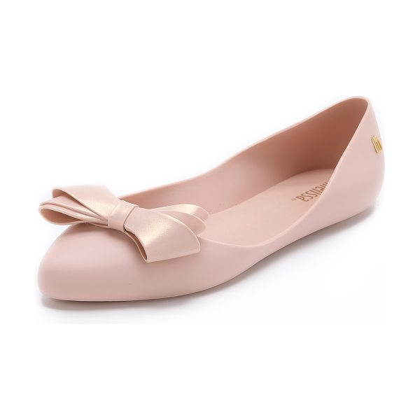 MELISSA Trippy iv bow flats in light pink - A curved top line lends a barely there look to matte PVC...