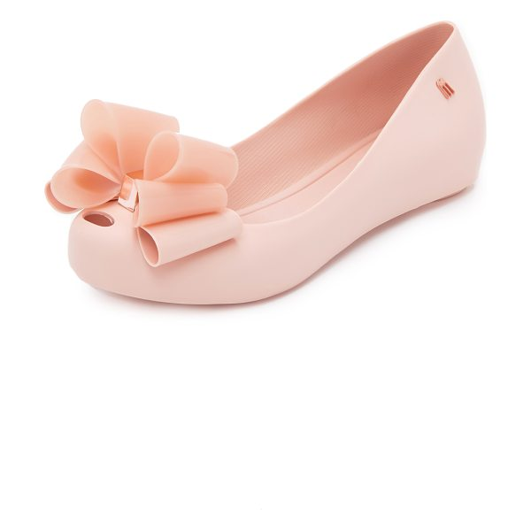 Melissa Ultragirl sweet x flats in light pink - A metallic accented bow and a petite cutout detail the...