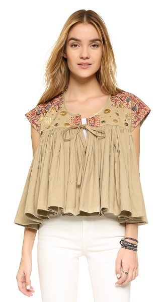 MES DEMOISELLES Myriade top in beige - Smooth embroidery and metal medallions lend an eclectic...