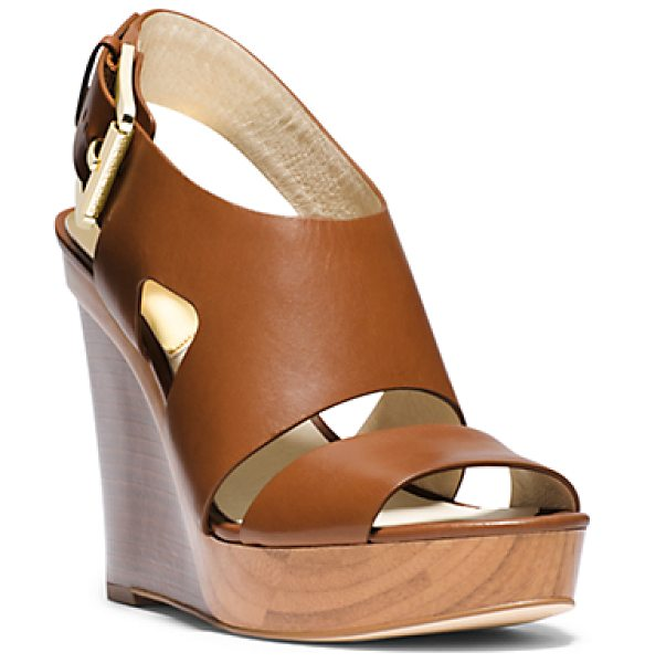 Michael Kors Carla Leather Wedge in brown - Contemporary Cutouts Feel Fresh On Our Towering Carla...