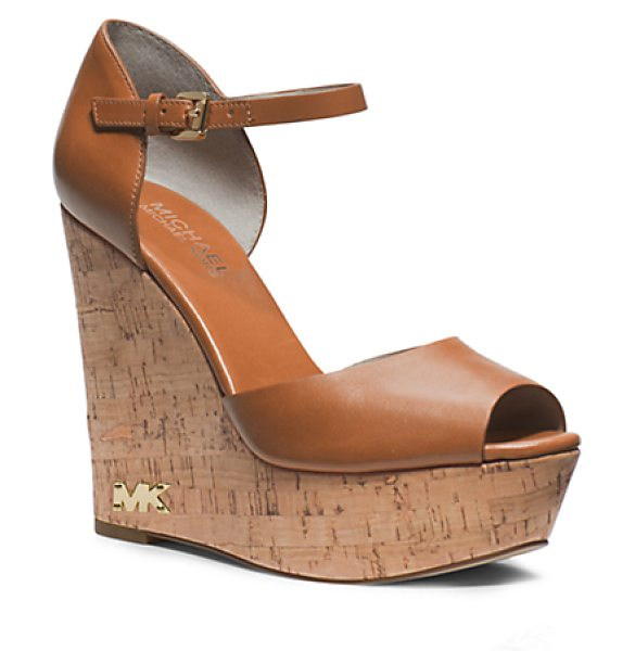 Michael Kors Ivana Leather And Cork Wedge in brown - The Sky's The Limit With Our Ivana Wedges A Vachetta...