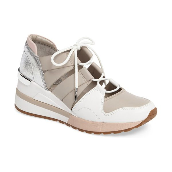 MICHAEL Michael Kors beckett ghillie wedge sneaker in cement/ soft pink leather - A deconstructed sneaker is reconstructed to run with...