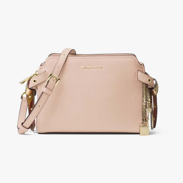MICHAEL Michael Kors Bristol Leather Crossbody in pink - Crafted From Pebbled Leather In A Chic And Compact...