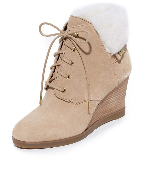 MICHAEL Michael Kors carrigan shearling wedge booties in dark khaki - A soft shearling cuff and a logo stud trims these...