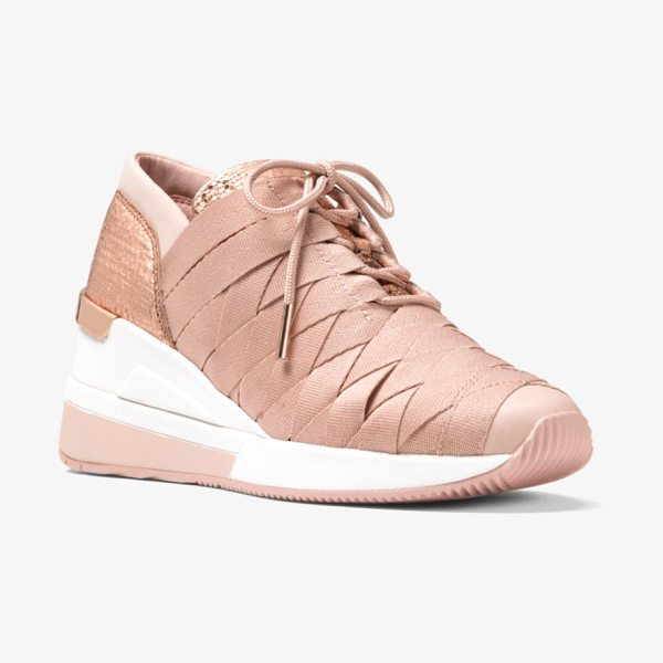MICHAEL Michael Kors Cydney Metallic Webbed Sneaker in pink - Constructured In A Webbed Design With Textured Metallic...