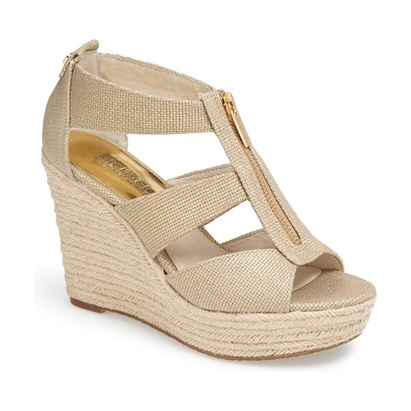 MICHAEL Michael Kors damita wedge sandal in gold - A logo-etched zipper skims the breezy straps of a woven...