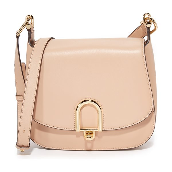 MICHAEL Michael Kors delfina saddle bag in oyster - Polished oval hardware punctuates the front of this...