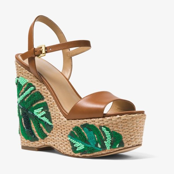 MICHAEL MICHAEL KORS Fisher Palm Embroidered Wedge in brown - Designed With Smooth Leather Straps And Set On A Soaring...