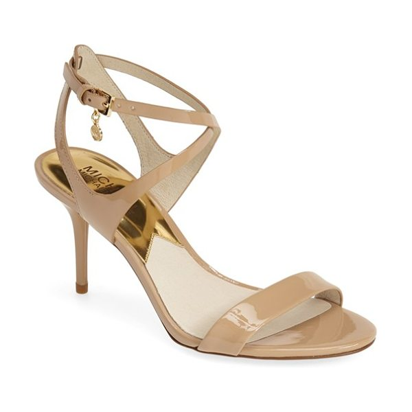 MICHAEL Michael Kors kaylee sandal in nude - A gleaming, logo-etched charm highlights the crisscross...