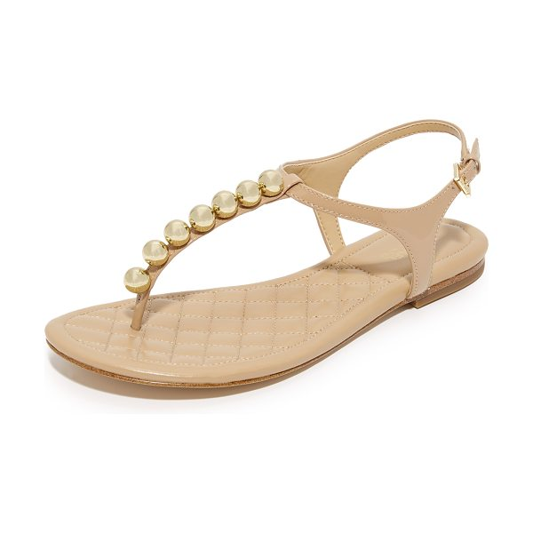 MICHAEL Michael Kors kirby flat sandals in toffee - Polished spheres accent the patent-leather T strap of...