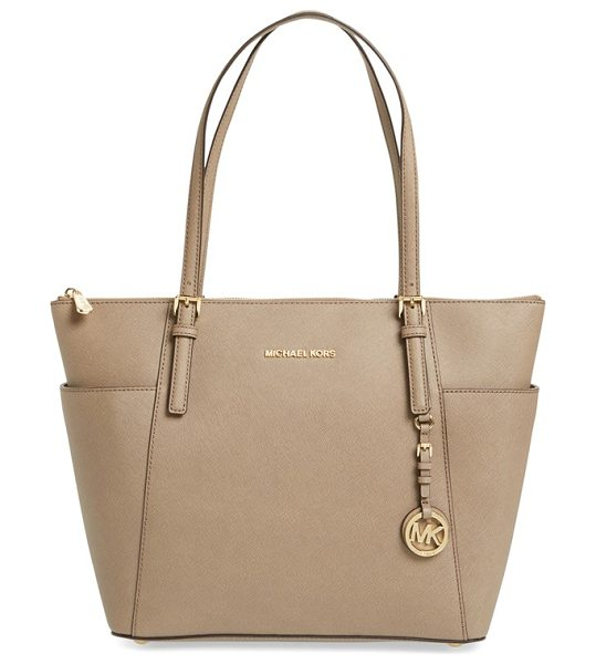 MICHAEL Michael Kors Large jet set travel tote in dark dune - Lavish Saffiano leather heightens the uptown...