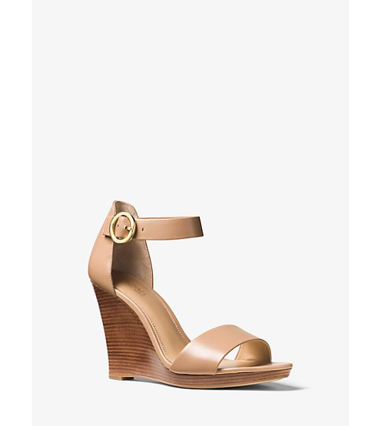 MICHAEL Michael Kors Lena Leather Wedge in brown - Fit With An Adjustable Ankle Strap And Stacked Heel Our...
