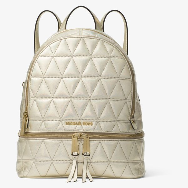 MICHAEL Michael Kors Rhea Medium Metallic Quilted-Leather Backpack in gold - Laid-Back Yet Luxe Our Rhea Backpack Redefines Big-City...