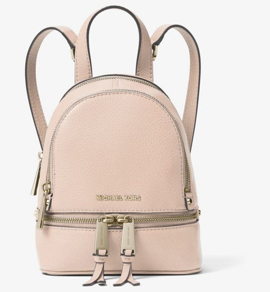 MICHAEL Michael Kors Rhea Mini Leather Backpack in pink - Crafted From Pebbled Leather Our Mini Rhea Backpack Is...