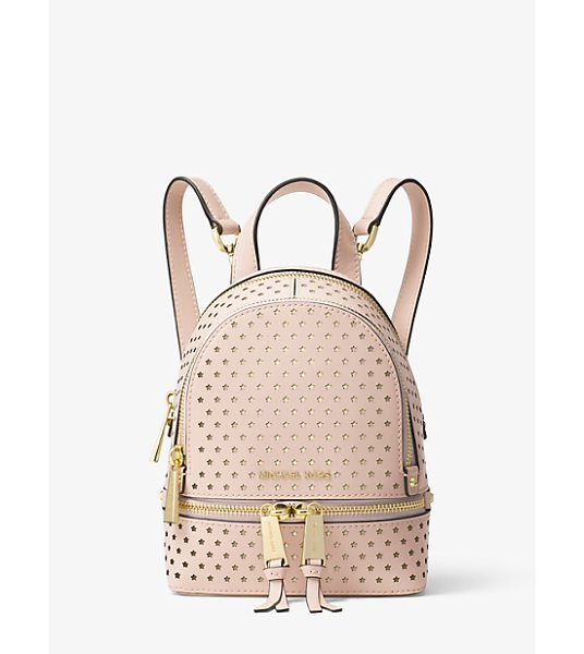 MICHAEL Michael Kors Rhea Mini Perforated Leather Backpack in pink - Star-Shaped Perforations Punctuate Our Mini Rhea...