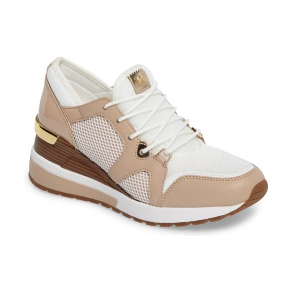 MICHAEL Michael Kors scout wedge sneaker in optic white/ oyster - Kick your casual look up a notch with a chic sneaker...