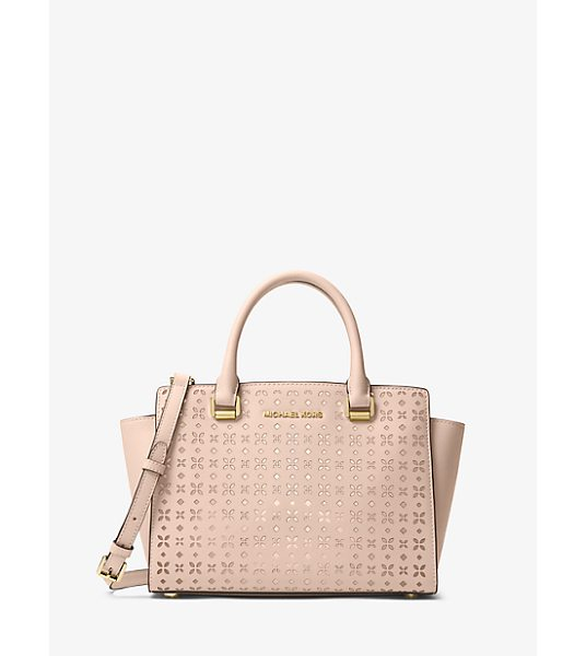 MICHAEL MICHAEL KORS Selma Medium Perforated Leather Messenger in pink - Our Selma Messenger Masters The Balance Between Edge And...