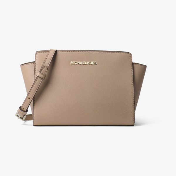 MICHAEL Michael Kors Selma Medium Saffiano Leather Messenger in brown - Our Selma Messenger Masters The Balance Between Edge And...